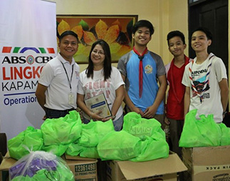 Representatives of Burgos High School turn over their donations to Operation Sagip