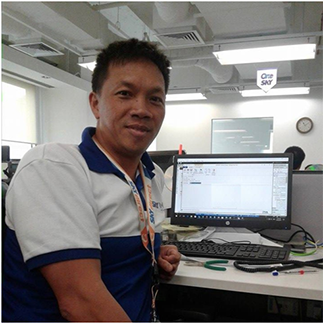 Coronel at his workstation