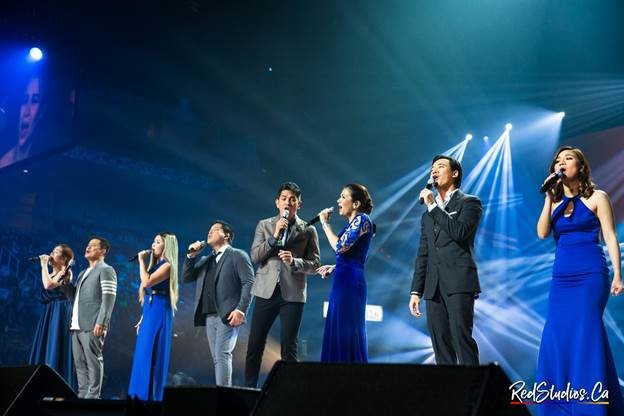 OPM's finest shine the spotlight on the silent, unrecognized heroes of the Philippines: the OFWs (Overseas Filipino Workers). (L-R) Angeline Quinto, Ogie Alcasid, Yeng Constantino, Martin Nievera, Gary Valenciano, ZsaZsa Padilla, Erik Santos, and Kyla sing a medley of songs celebrating Pinoy pride. (Photo courtesy of Red Andal.)
