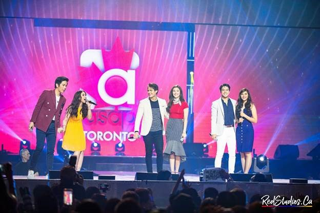 "The glow in their eyes can make one believe in ""forever."" Cupid's arrow strikes, and the coliseum crowd goes wild as the love teams of (left to right) Joshua Garcia and Julia Barretto; Enrique Gil and Liza Soberano; and Elmo Magalona and Janella Salvador sing about what makes them love someone. (Photo courtesy of Red Andal.)"