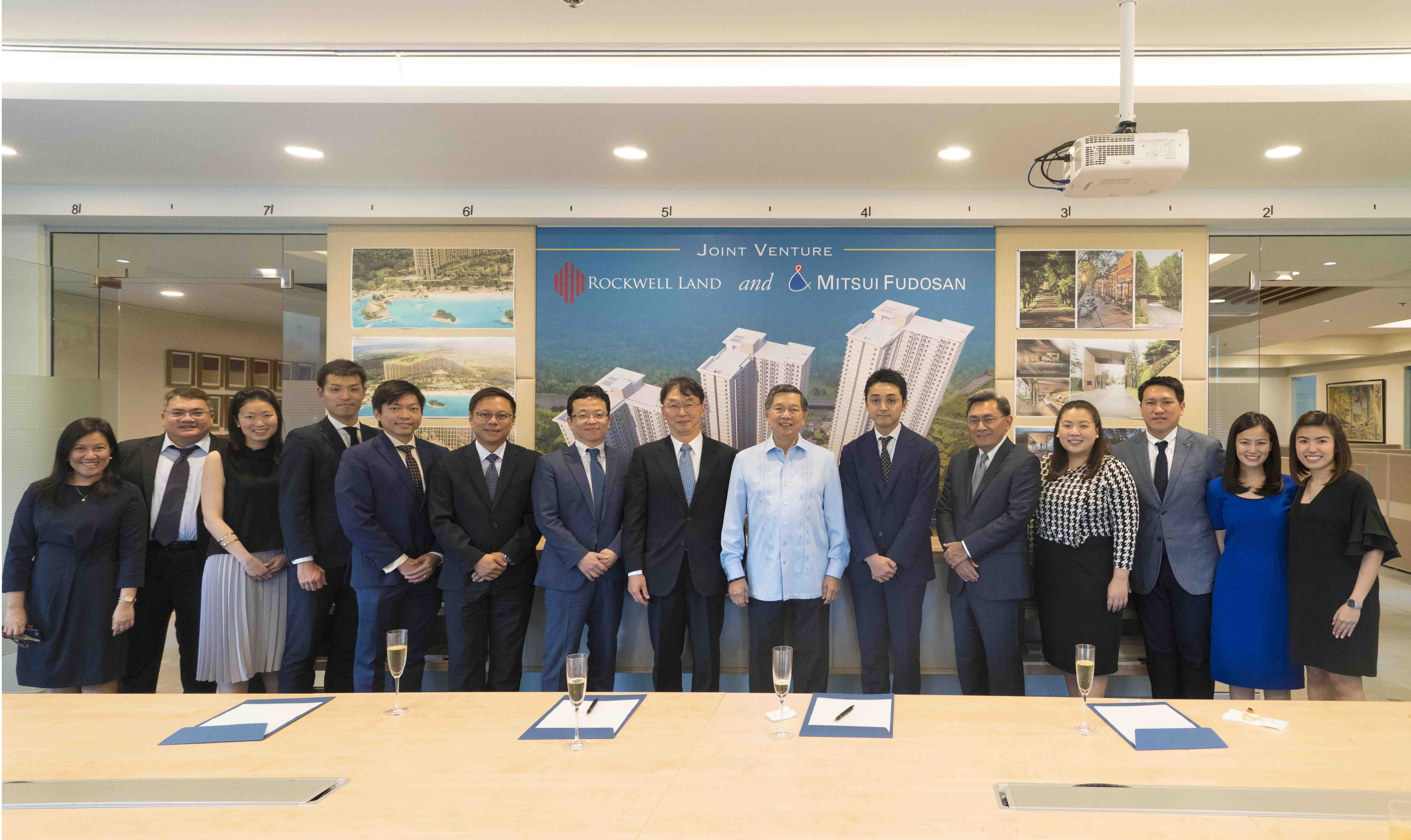 Rockwell Land chairman Ambassador Manuel M. Lopez (9th from left), president Nestor J. Padilla (11th from left) and SVP Mike Lopez (6th from left) with the Rockwell Land team and Mitsui Fudosan Asia Pte. Ltd. representatives