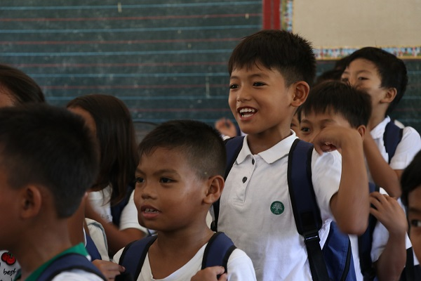 Prince Jared Calundoy, a pupil at Asinan Elementary School, smiles after receiving his Gusto Kong Mag-Aral bag