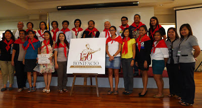 "The awardees, with NHCP personnel, wear the official scarves that signify they completed ""Biyaheng Bonifacio"""
