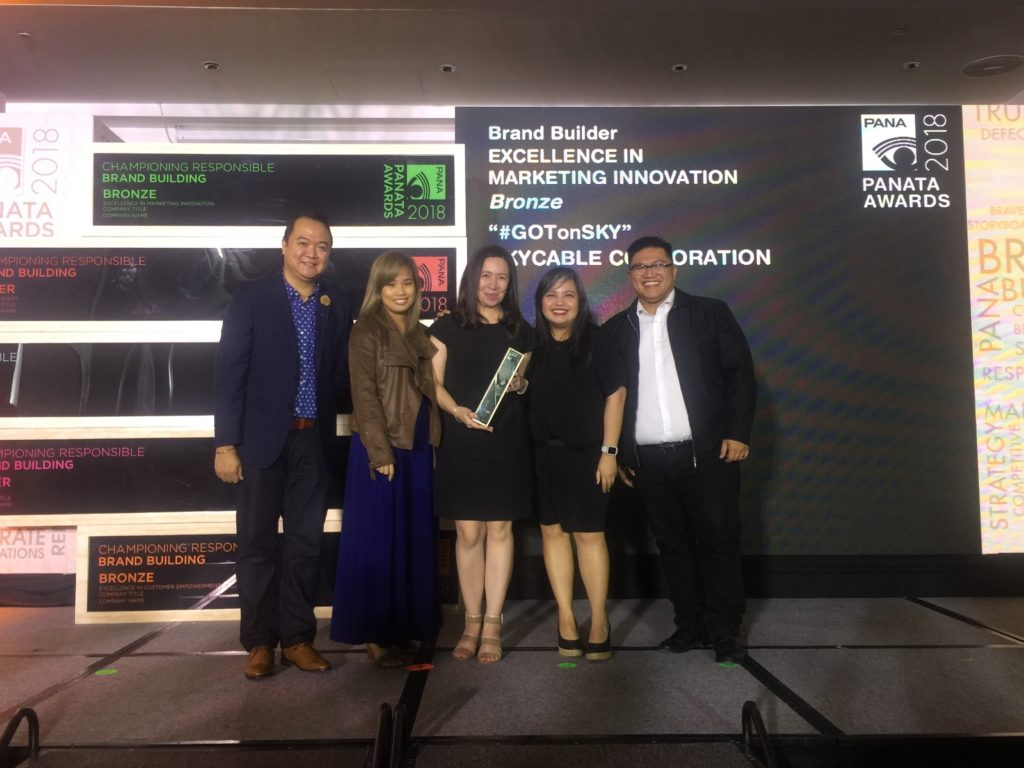 Celine Vitan, Kathy Maristela and Gel Jose receive SKY's bronze award for Brand Builder Excellence in Marketing Innovation from PANATA representatives