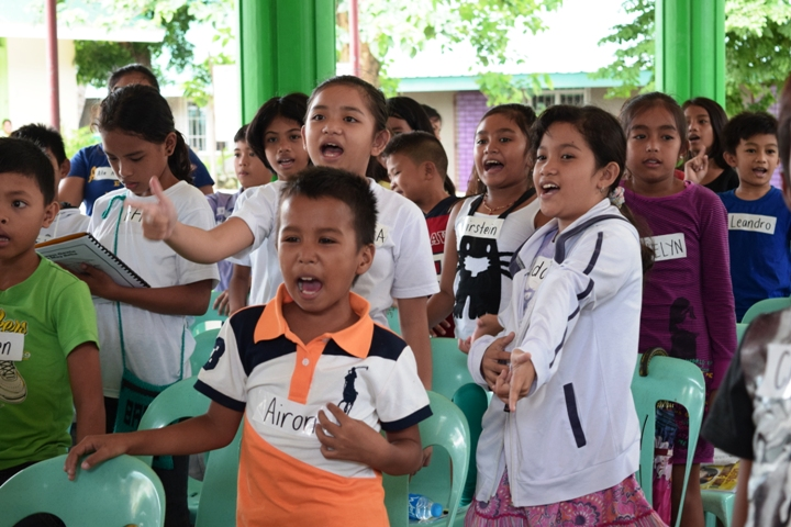"Ada Sebelyeno (right, in white jacket) practices the ""Ligtas ang Batang Handa"" moves with her schoolmates"