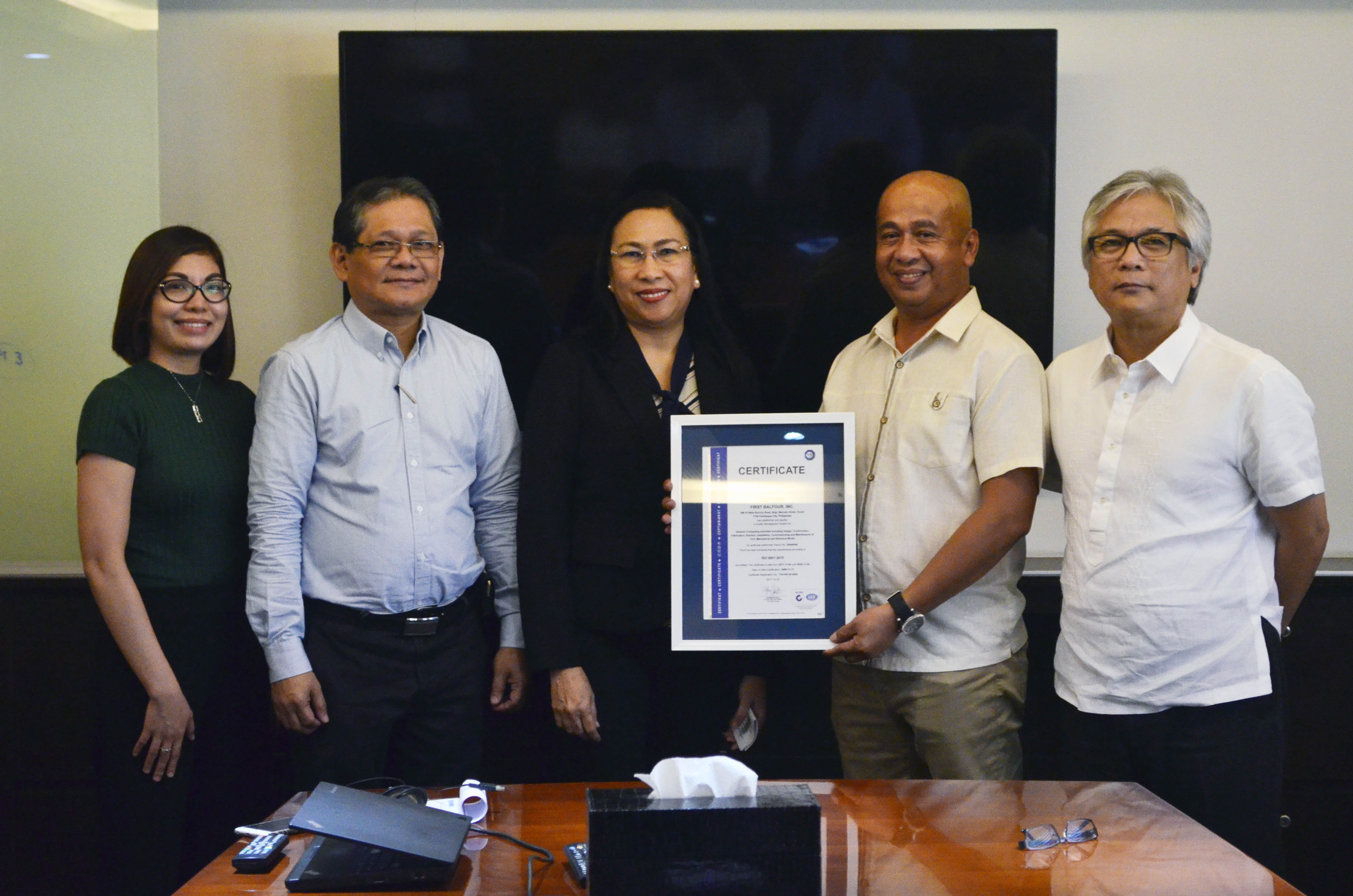 From right: First Balfour president and COO Anthony Fernandez, Corporate Quality head Jose Lagdan Jr., TUV SUD lead auditor Eunice Sol Diamante, First Balfour EVP Rey Villar and TUV SUD account executive Ednalyn Olivia