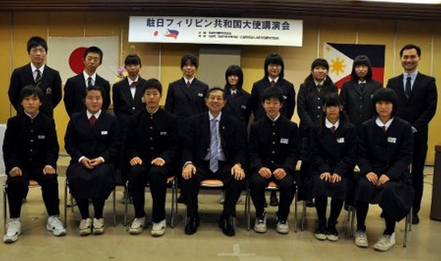 Ambassador Manuel M. Lopez poses with students of Takahata Town
