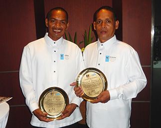 Security officers Victorino Gubalane left of Silver Link Security and Investigative Services Inc. and Julius Ravelo right of Powerlink Security and Investigative Services Inc. holding their Yolanda Hero Awards