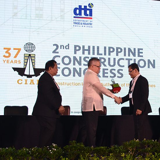 EVP Rey Villar (right) receives First Balfour's award from DTI Sec. Ramon Lopez and CIAP executive director Ramon Abiera