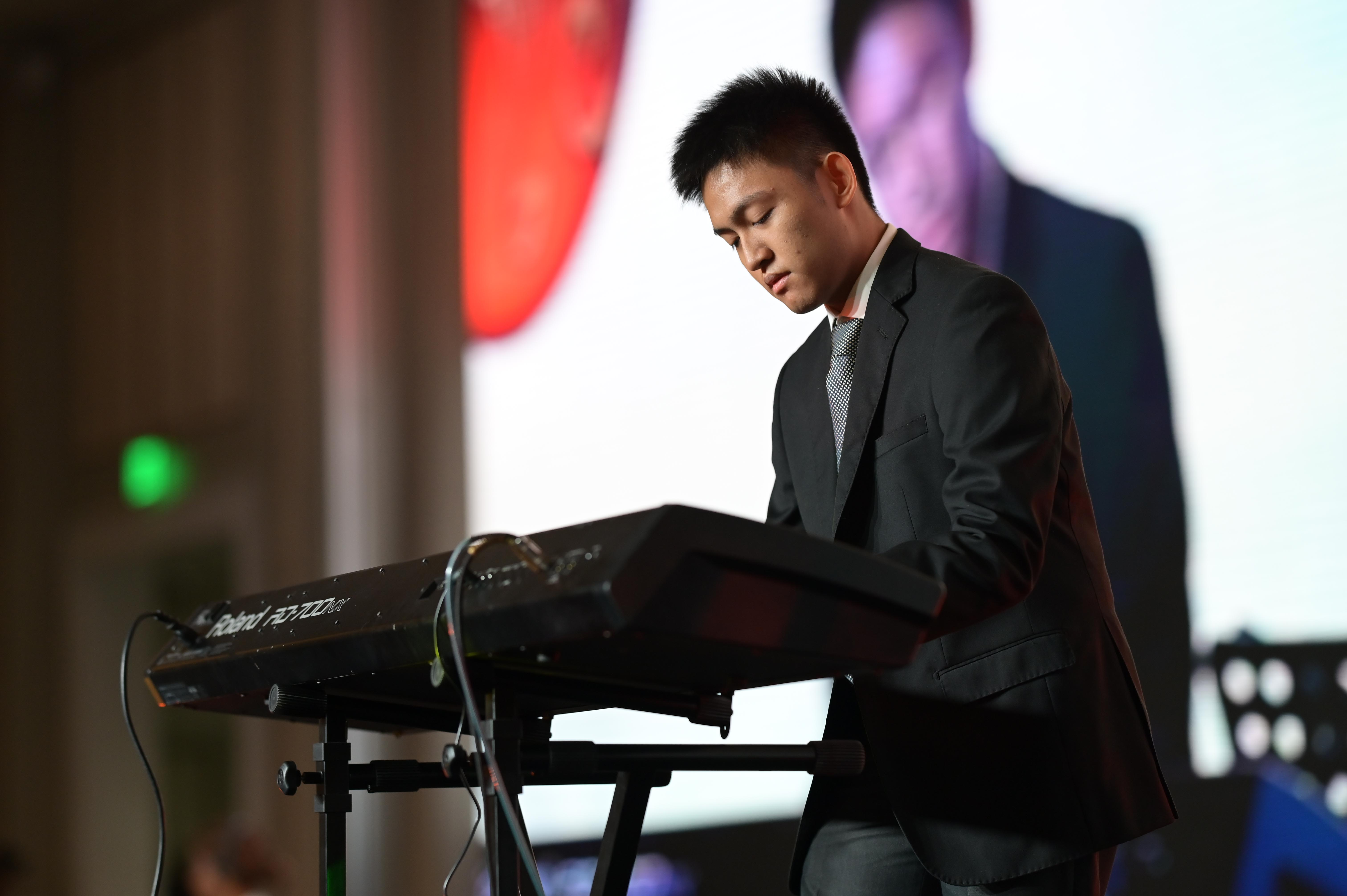 Joachim Navarro, a music scholar at the National University of Singapore, performs during the dinner