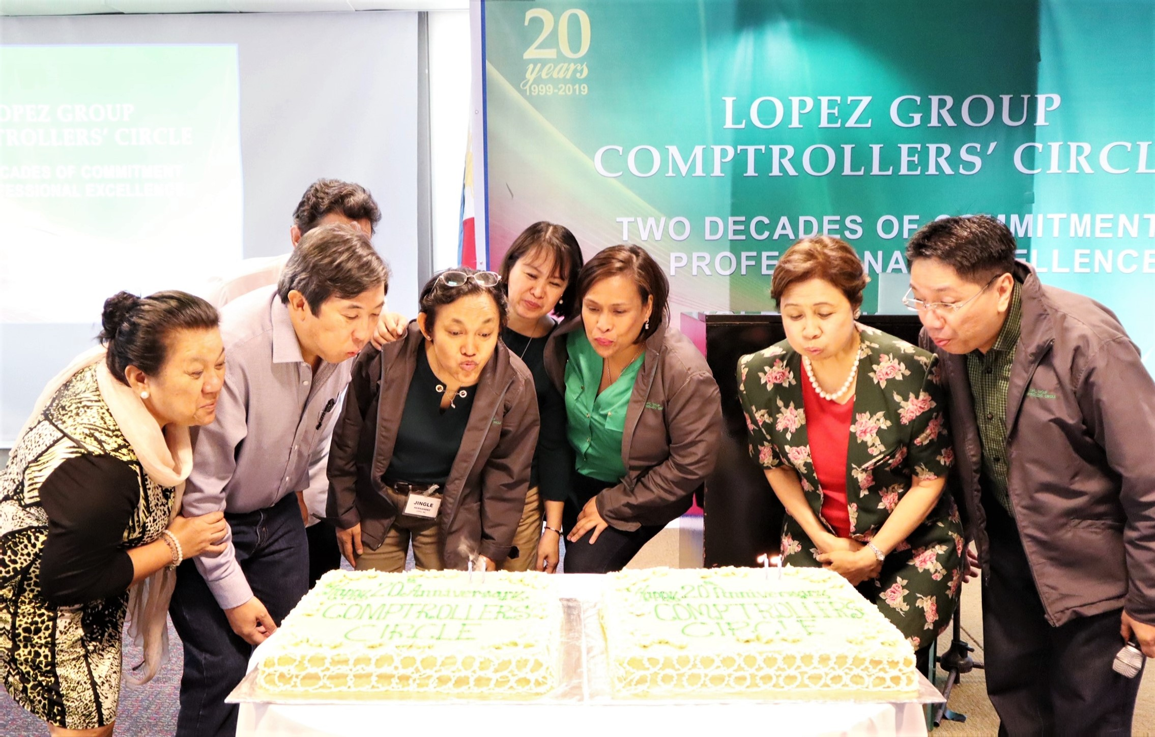 Past and present officers and core team members blow the candles on the 20th anniversary cake
