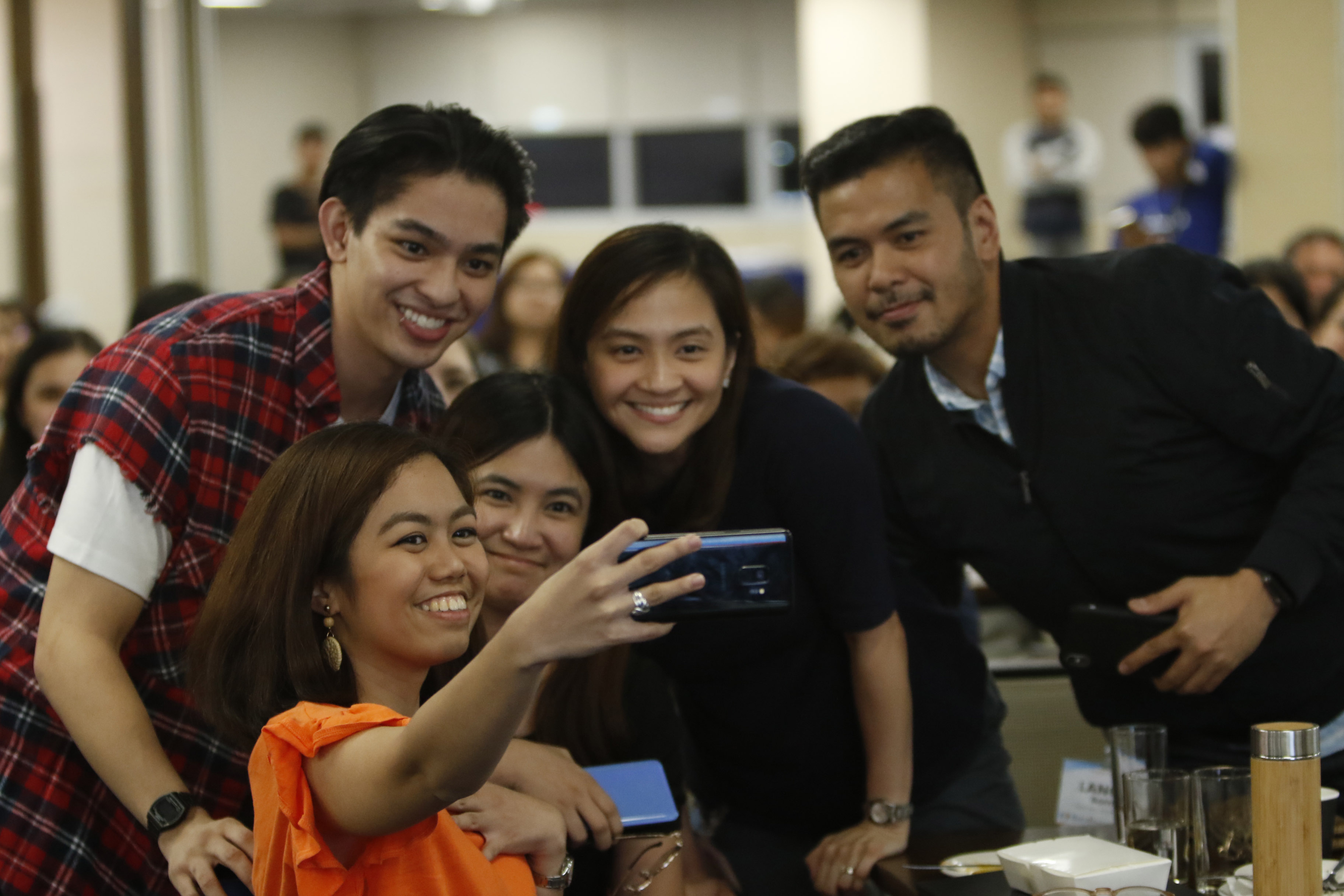 Attendees take a selfie with BoyBandPH member Joao Constancia