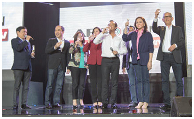 ABS-CBN executives led by chairman Eugenio Lopez III and president Charo Santos-Concio toast the new channel during the January 2014 launch