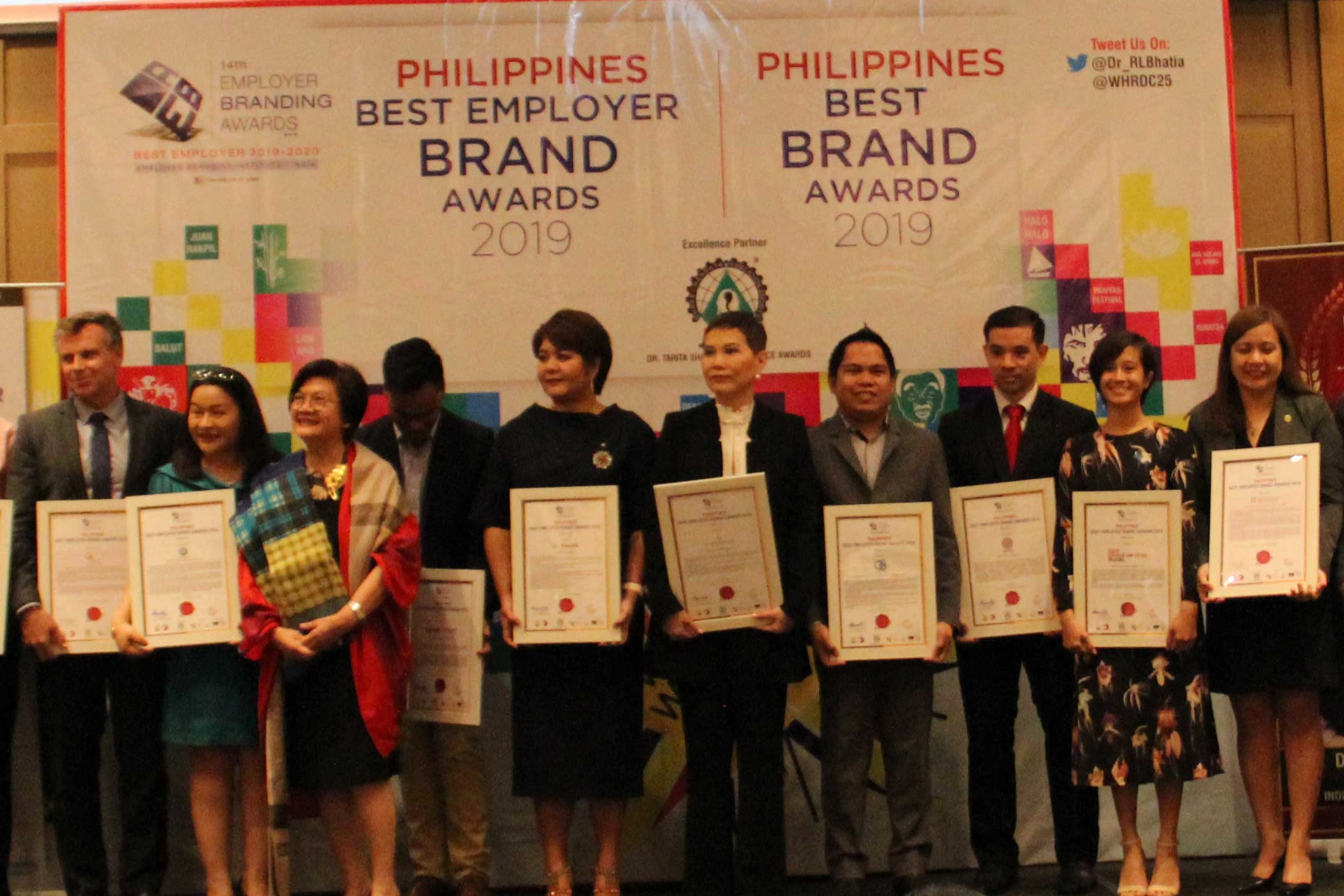 Paulo Tatad (3rd from right), recruitment marketing and sourcing head, receives the award on behalf of ABS-CBN