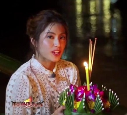 Join Gretchen as she participates in the Loy Krathong Festival