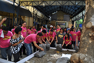 KCFI president Rina Lopez-Bautista (front row, right) leads the vegetable-planting activity