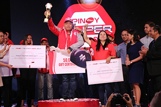 Alberto Abad holds up his trophy and other prizes after winning the search for model Filipino drivers