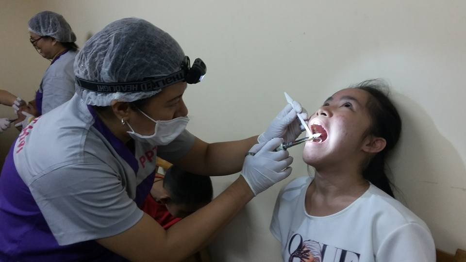 Tooth extraction during one of PAAFI's medical and dental missions