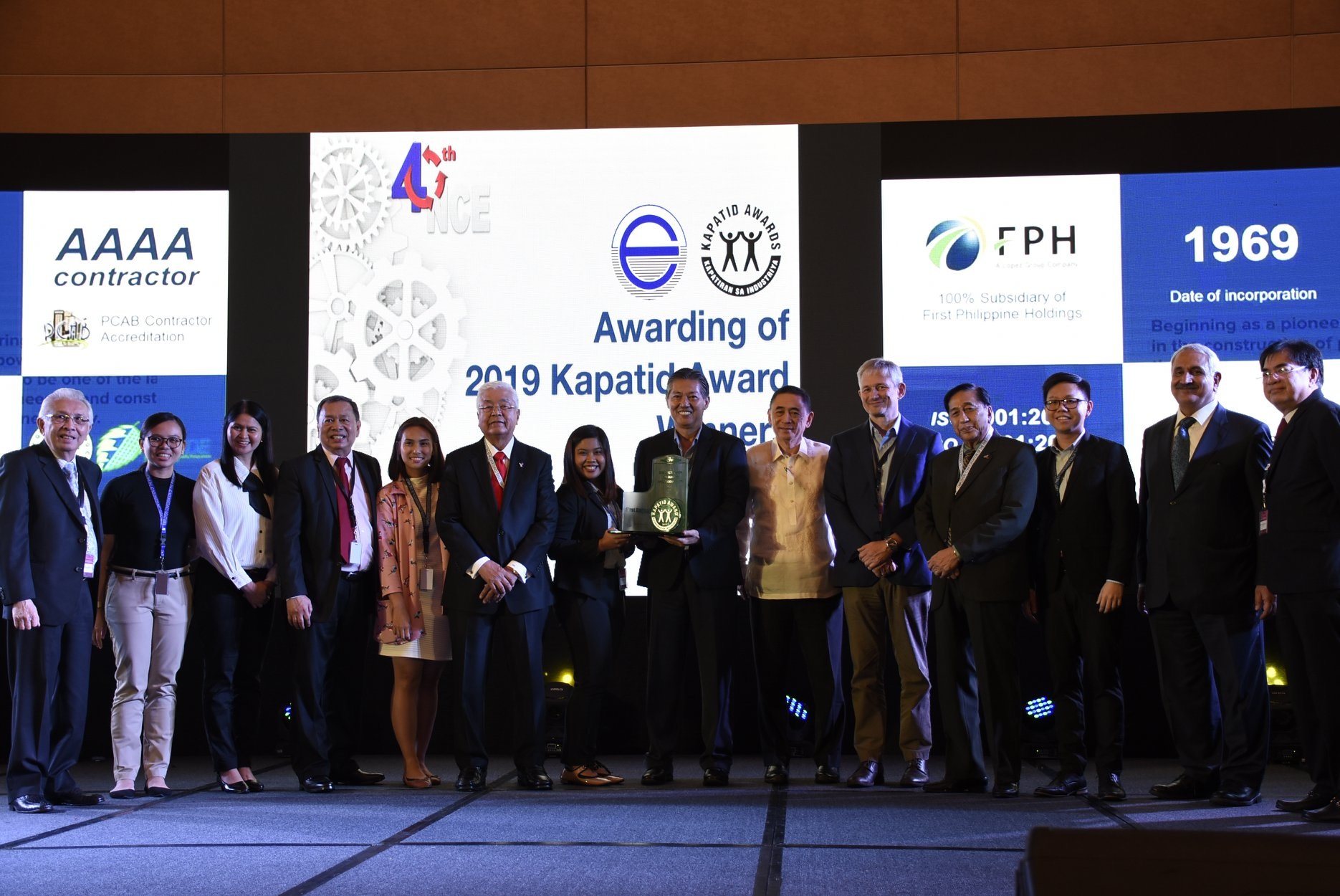 The First Balfour team, led by HR and administration head Carlos Salonga (8th from left), receives the award from ECOP officials
