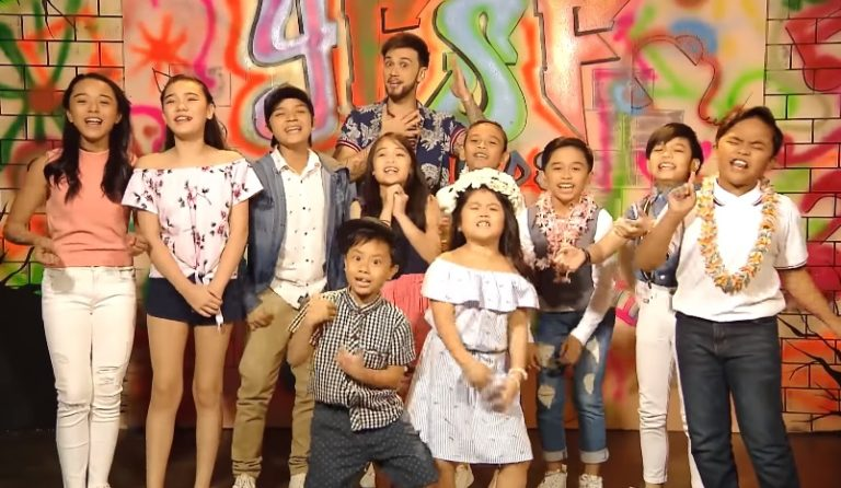Host Billy Crawford (back row) hams it up with the young impersonators