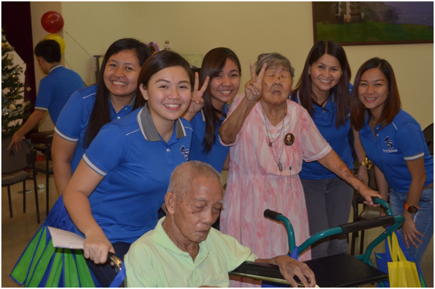 Anchel Cruz (2nd from left) and her colleagues at the San Lorenzo Ruiz Home for the Elderly