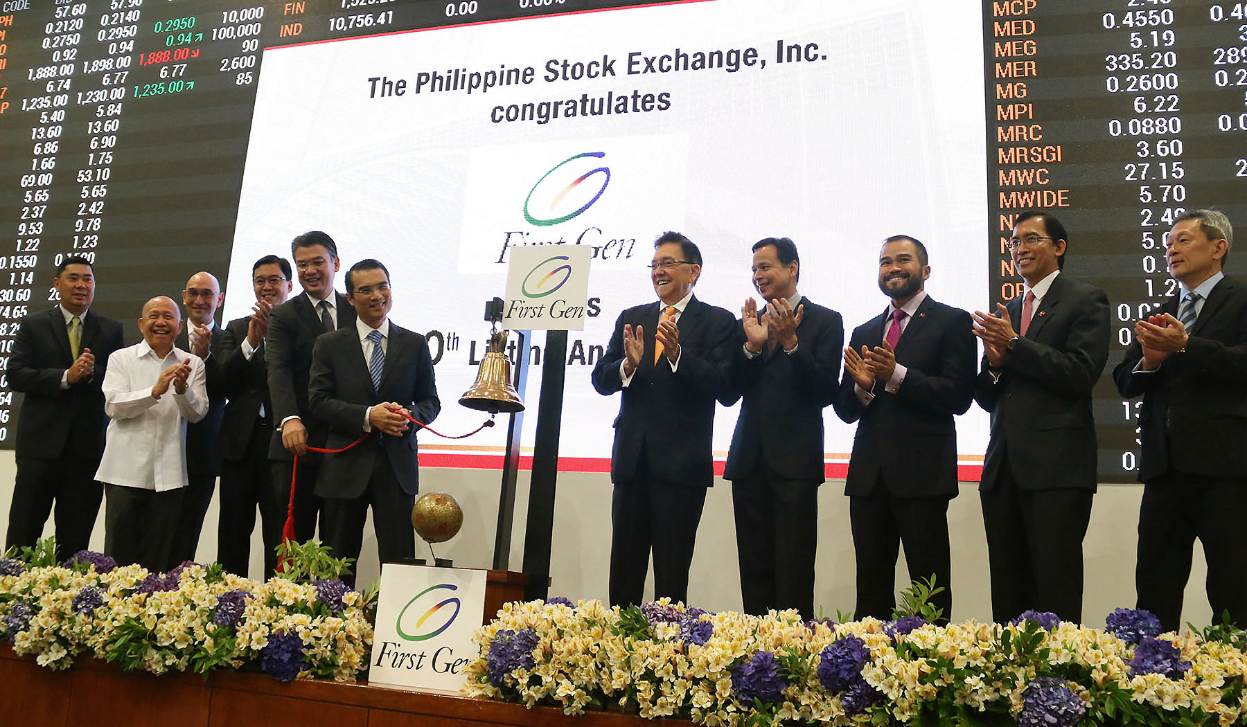 First Gen chairman and chief executive officer Federico R. Lopez (center) with (l-r) senior vice president and compliance officer Victor Emmanuel Santos Jr., director Elpidio Ibañez, senior vice president and chief financial officer and treasurer Emmanuel Singson, executive vice president and director Richard Tantoco, president and chief operating officer Francis Giles Puno, PSE chairman Jose Pardo, director Emmanuel Bautista, chief operating officer Roel Refran, president and chief executive officer Hans Sicat and director Alejandro Yu.