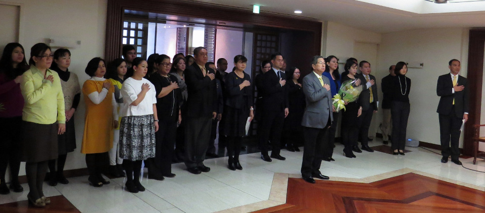 Ambassador Manuel M. Lopez and embassy personnel sing the national anthem