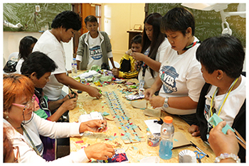 Pasig River Warriors get busy during a workshop with artist Alma Quinto