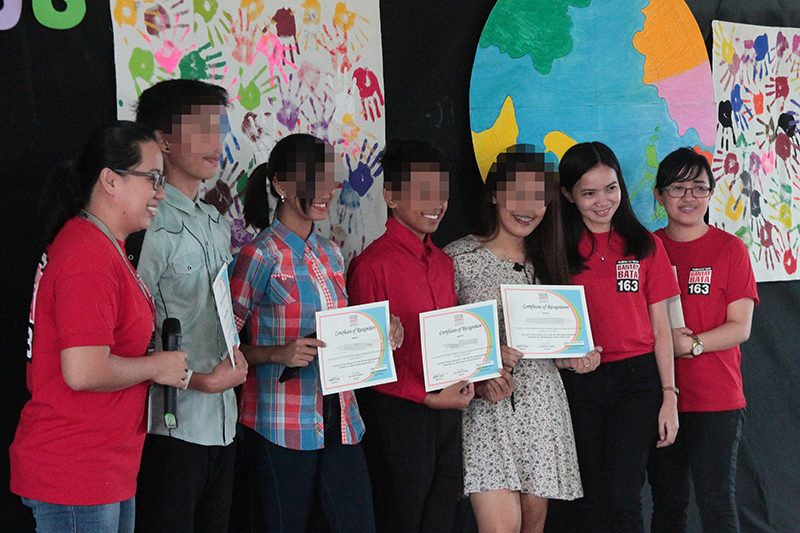 Young academic achievers cap a successful school year with Bantay Bata 163 staff (faces have been blurred to protect the students' identities