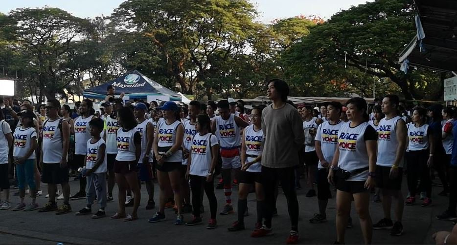 Runners wait for the starting gun