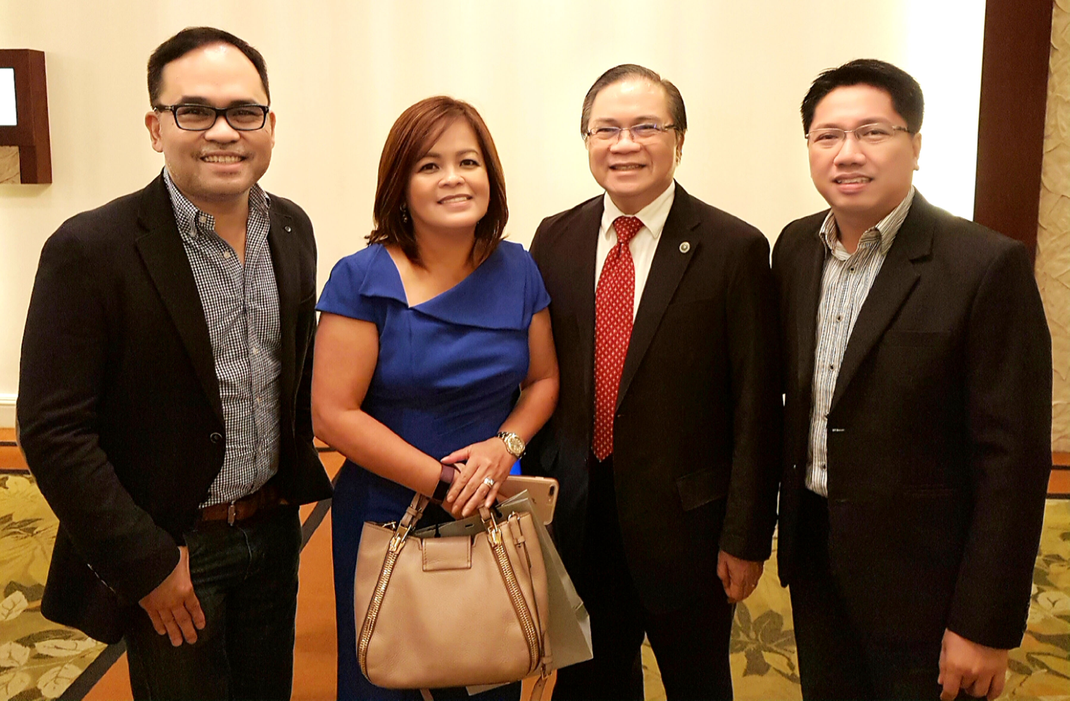 Comptrollers' Circle core team members Aldrin Cerrado and Jei-Jei Gertes flank guest speaker Ging Reyes, head of ABS-CBN News and Current Affairs, and Board of Accountancy deputy commissioner Gerry Sanvictores during the opening of Accountancy Week