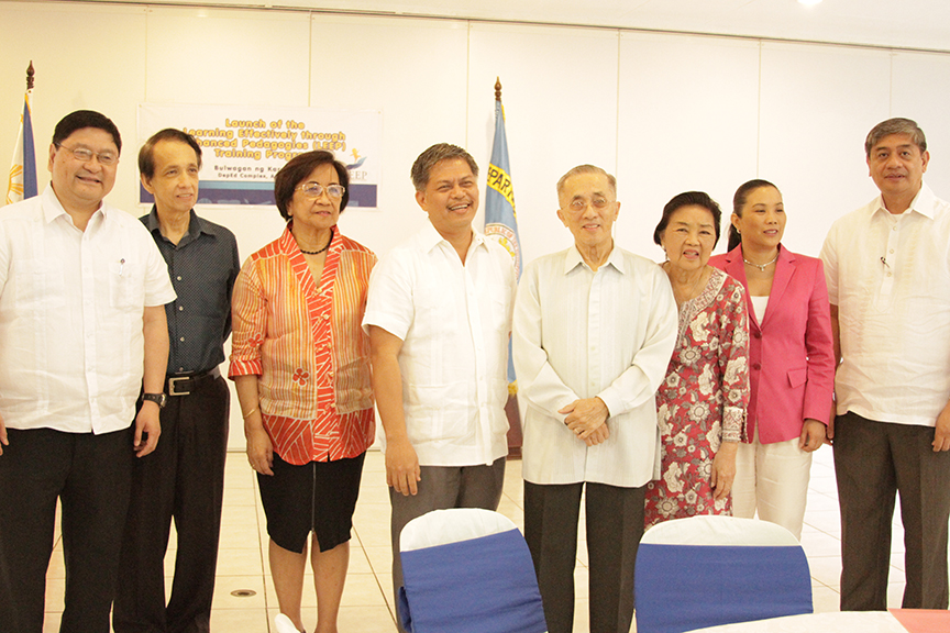 The Lopezes—Lopez Group chairman emeritus Oscar M. Lopez, Connie R. Lopez and KCFI president Rina Lopez Bautista (5th, 6th and 7th from left)—with (l-r) DepEd Usec. Rizalino Rivera, Bayan Academy's Prof. Ed Morato, KCh consultant Dr. Fe Hidalgo, DepEd Sec. Bro. Armin Luistro and Usec. Alberto Muyot at the launch of LEEP in April