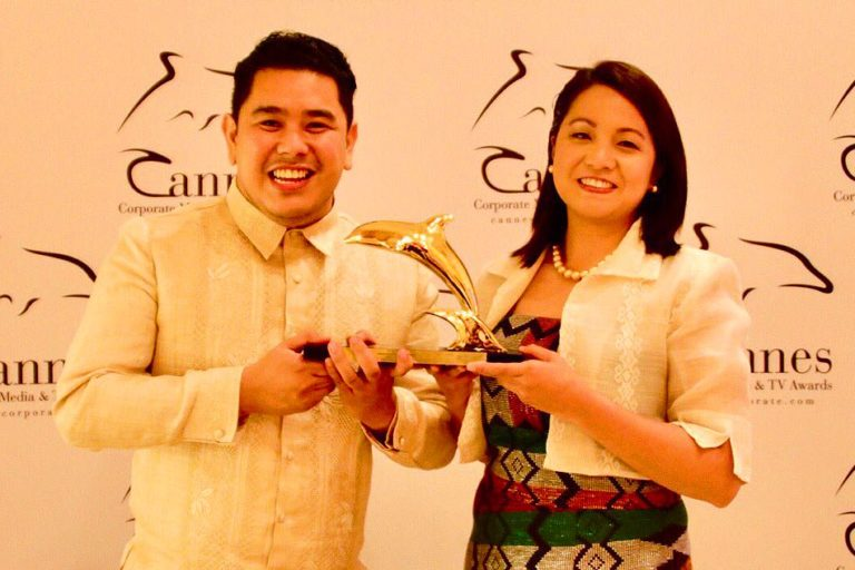 Jeff Canoy and Chiara Zambrano show off the Philippines' first Gold Dolphin award