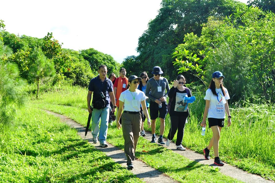 The HR Council's Cedie Lopez Vargas leads a group in navigating an uphill trail