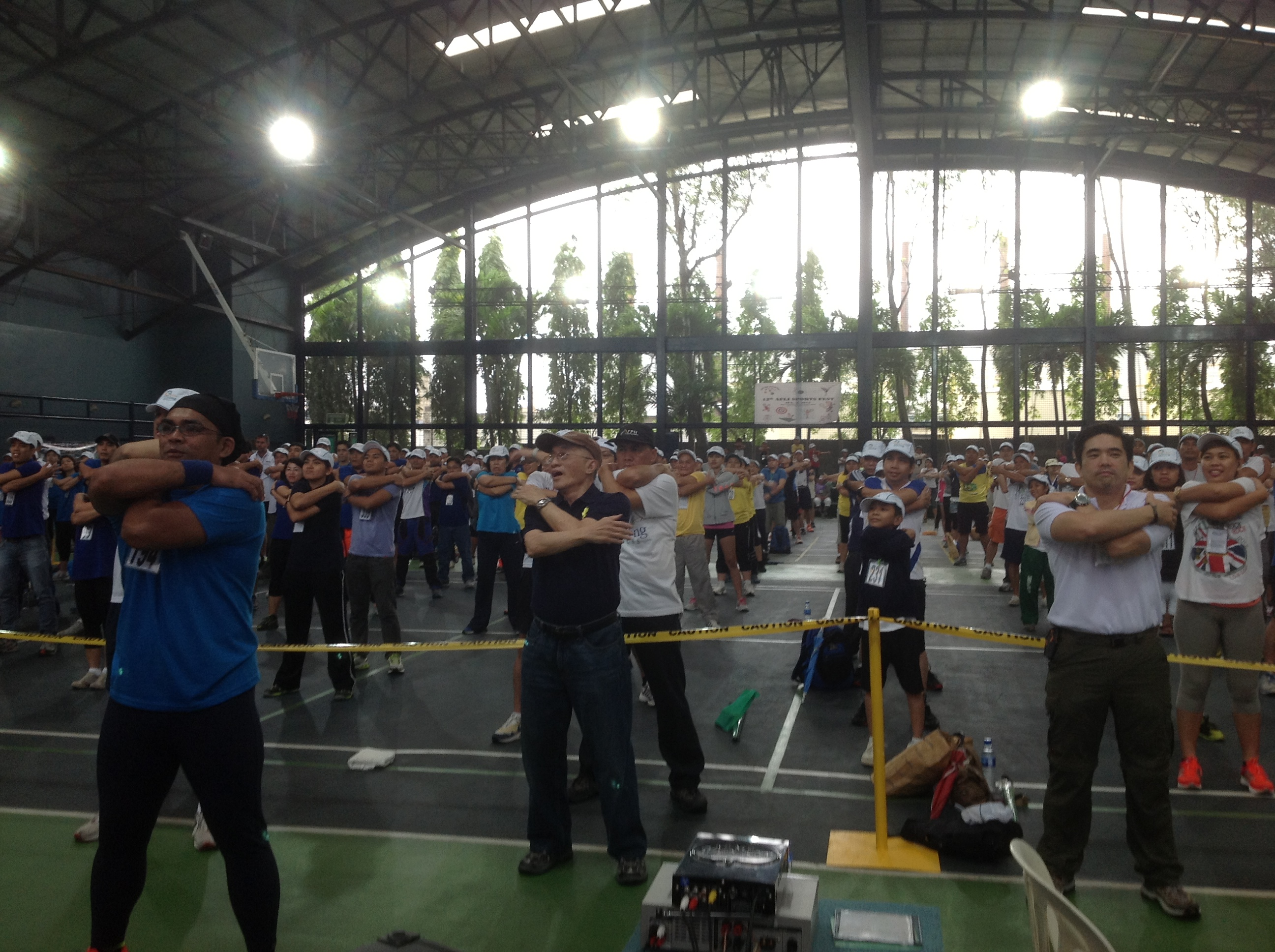 Lopez Group chairman emeritus Oscar M. Lopez and FPH VP Benjamin R. Lopez lead the Walk the Talk attendees in performing the mandatory warm-up exercises