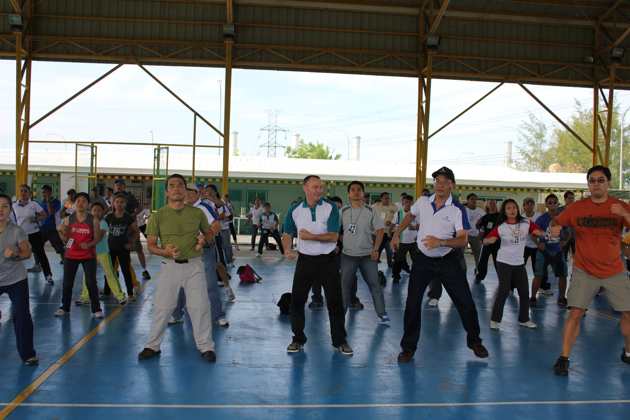 PH chairman Federico R. Lopez (right) and other Lopez Group executives limber up for the walk ahead