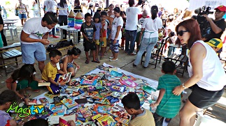 Pupils show off their new school supplies during a Project Lapis turnover, also in Cebu