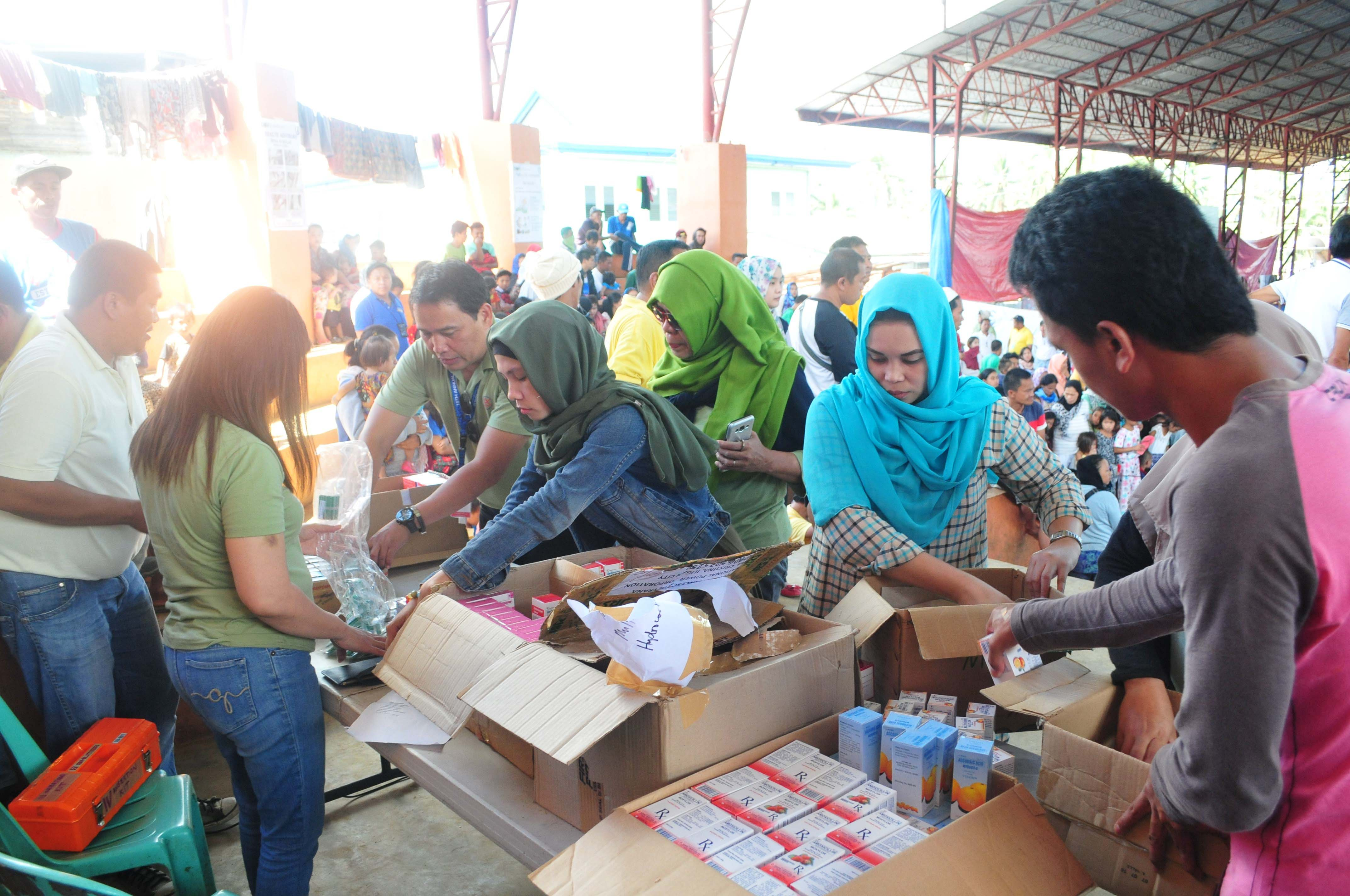Volunteers sort medicines during a relief operation