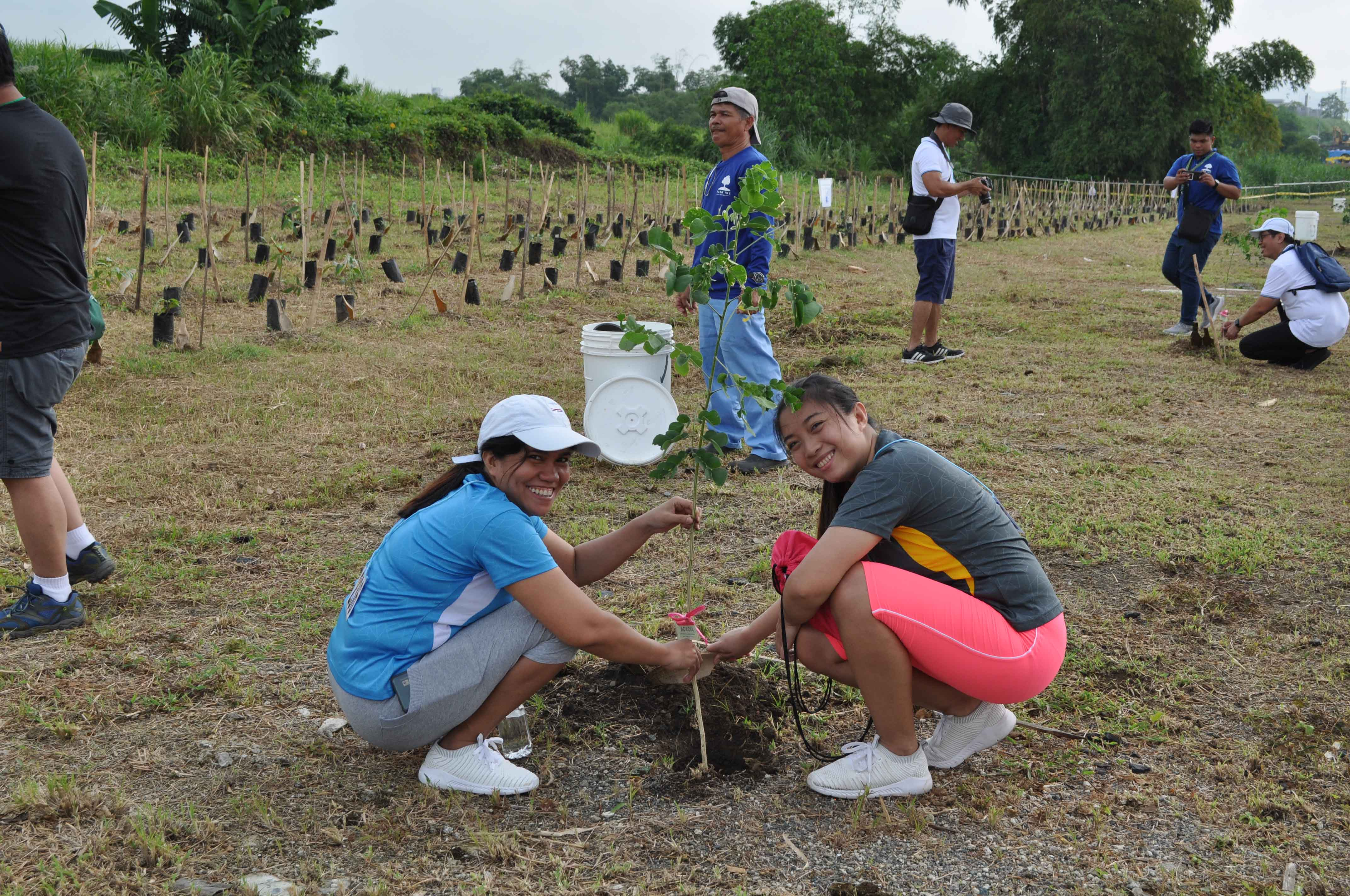 Planting trees is a WTT tradition at FPIP