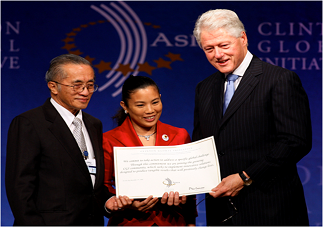Rina Lopez Bautista, Oscar M. Lopez with Bill Clinton
