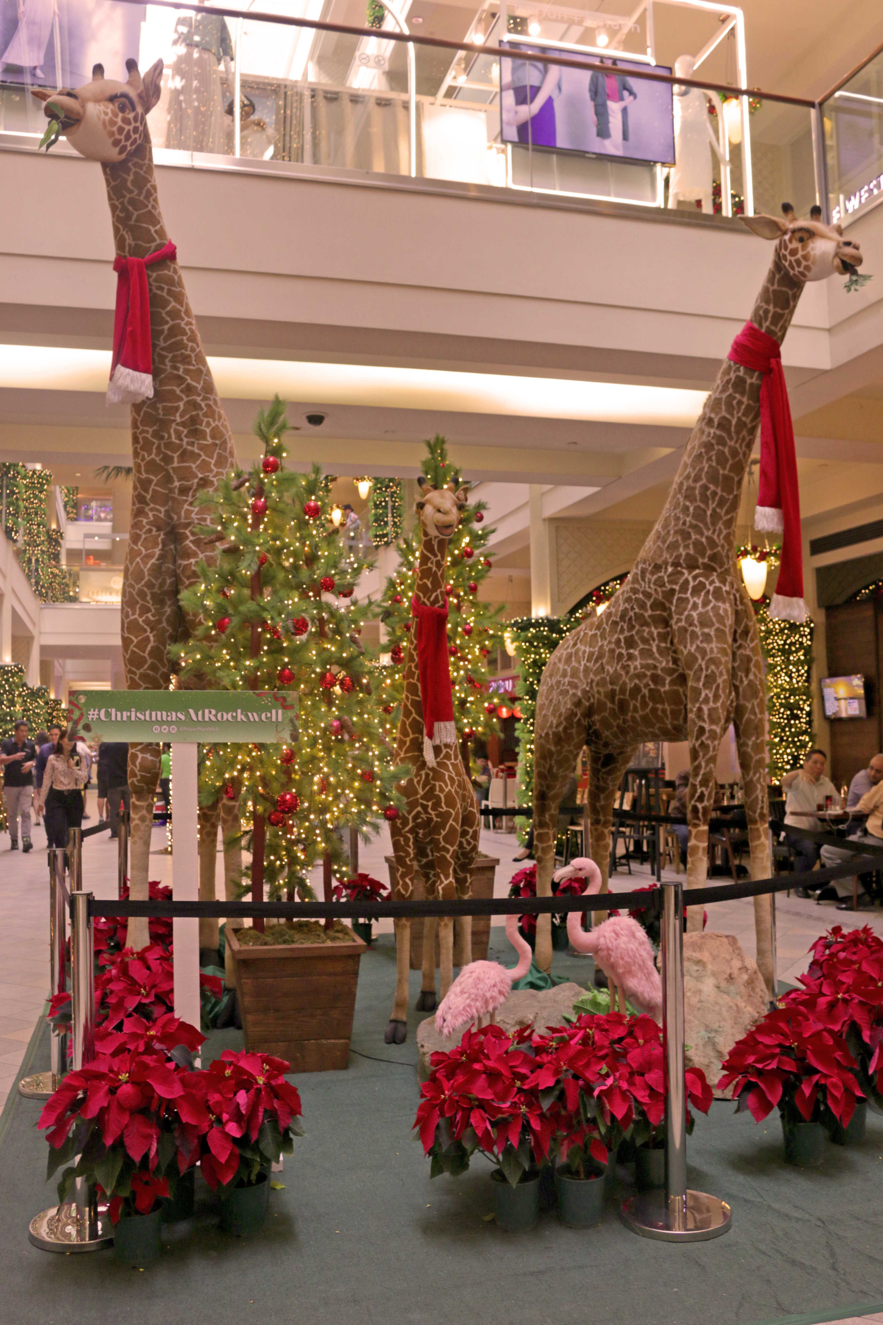 Giraffes tower over shoppers at the P1 Level