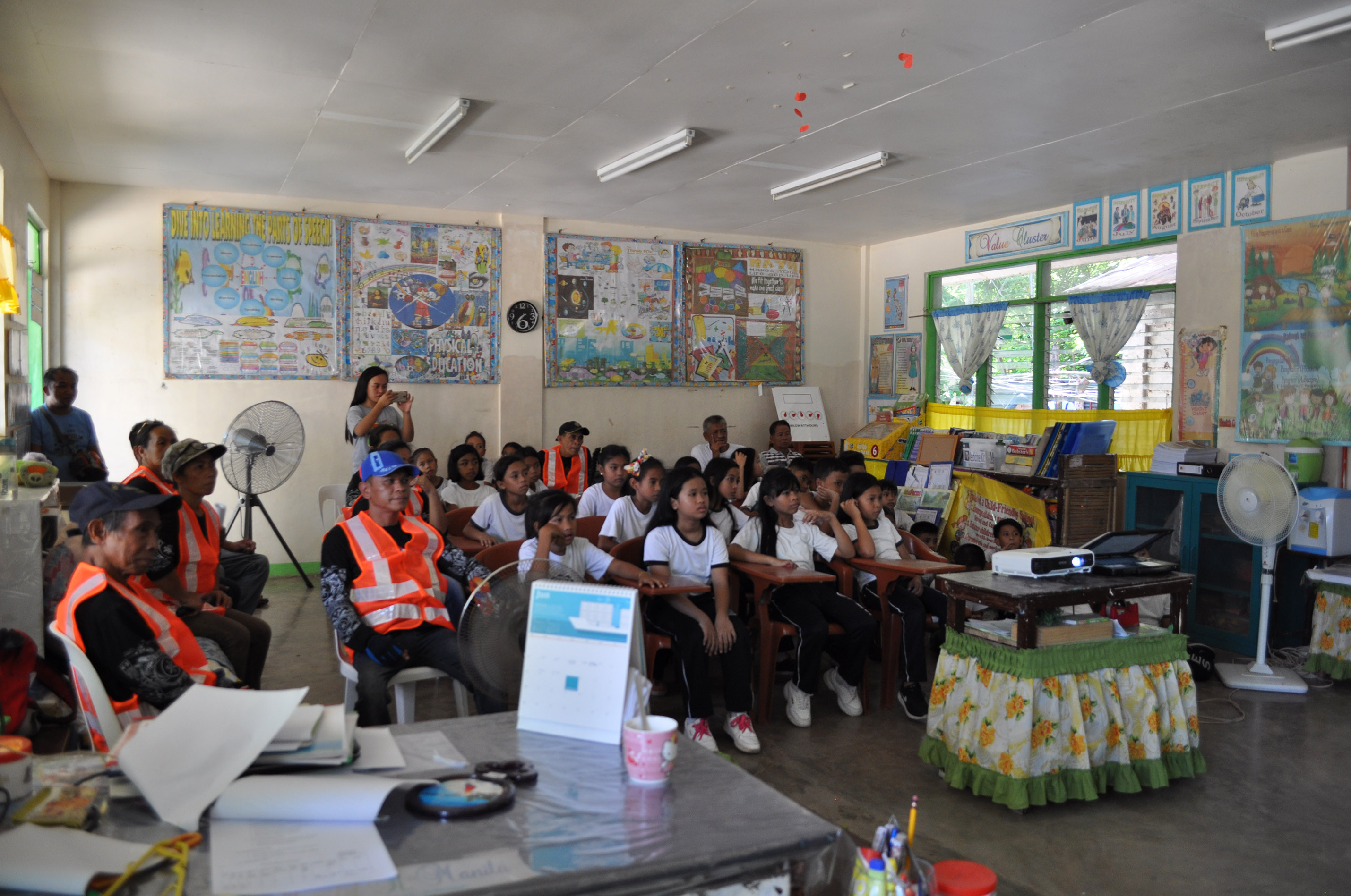 Students, teachers and members of the barangay emergency team attend the emergency response seminar