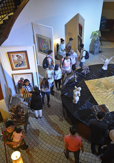 Guests check out the works of Rizal's leading artists in the 'Coup de Maitre' exhibit
