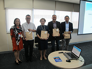 LGFI president Cedie Lopez Vargas presents tokens of appreciation to LCC speakers Marco Amurao of FPIP, Marianne Quebral of OML Center, and Robert Suntay and Joal Ascalon of SEA Institute