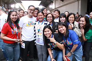 Groups of employees line up for photos with president & CEO Carlo L. Katigbak