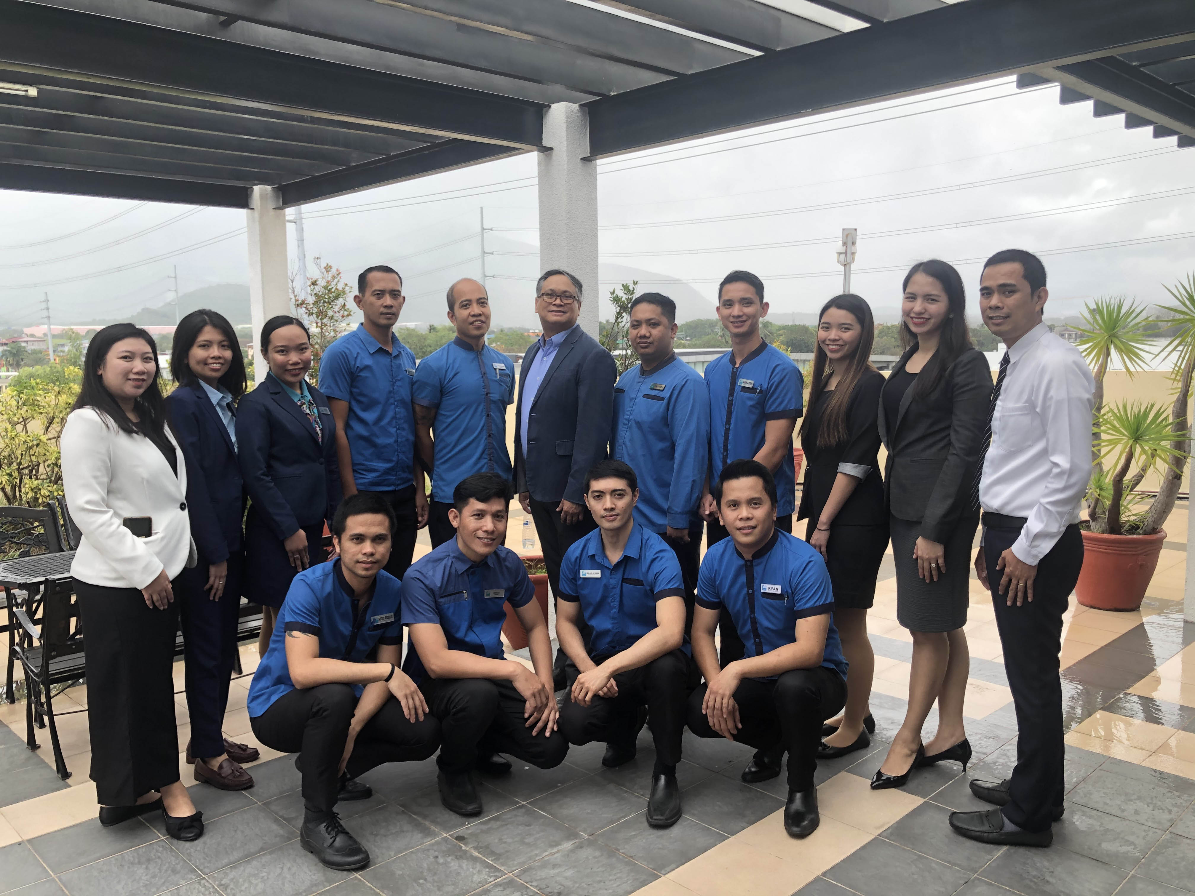 Standing, l-r: Deseree Joy Velasco, accounting; Renz Miel Manalo, accounting staff; Mary Rose Atienza, front office agent; Joseph Varela, housekeeping supervisor; Ferdinand Nario, maintenance; Norman Eusebio, general manager; Patrick Pasahol, bellman/driver; Mark Aldrin Pulido, room attendant; Mikaela Montero, sales associate; Manilyn dela Cruz, sales supervisor; and Tito Mercado, senior front office supervisor; Front row, l-r: Astly Rizelle Alidio, room attendant; Jermias Aguila, painter; Gerald Eguia, housekeeping team leader; and Ryan Cañete, room attendant