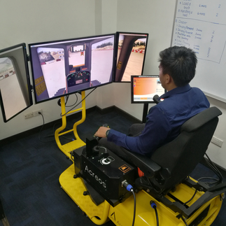 An employee tries out the ACREOS simulator