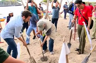 OML (center), with FPH VP Benjamin R. Lopez (right), leads the groundbreaking for Binabaywan
