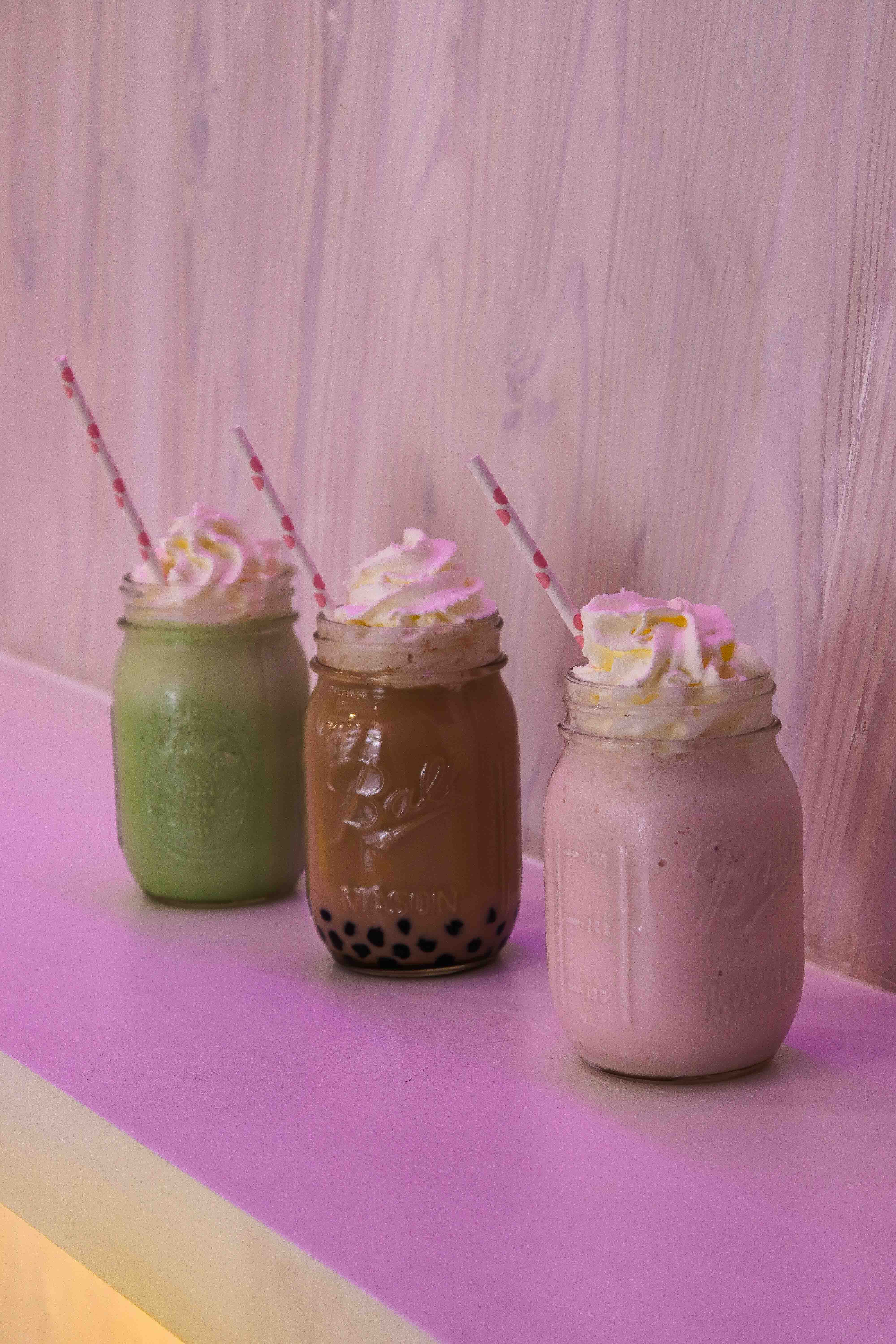 Our votes go to Milk Barn's green tea, brown sugar with pearls, and strawberry milkshakes
