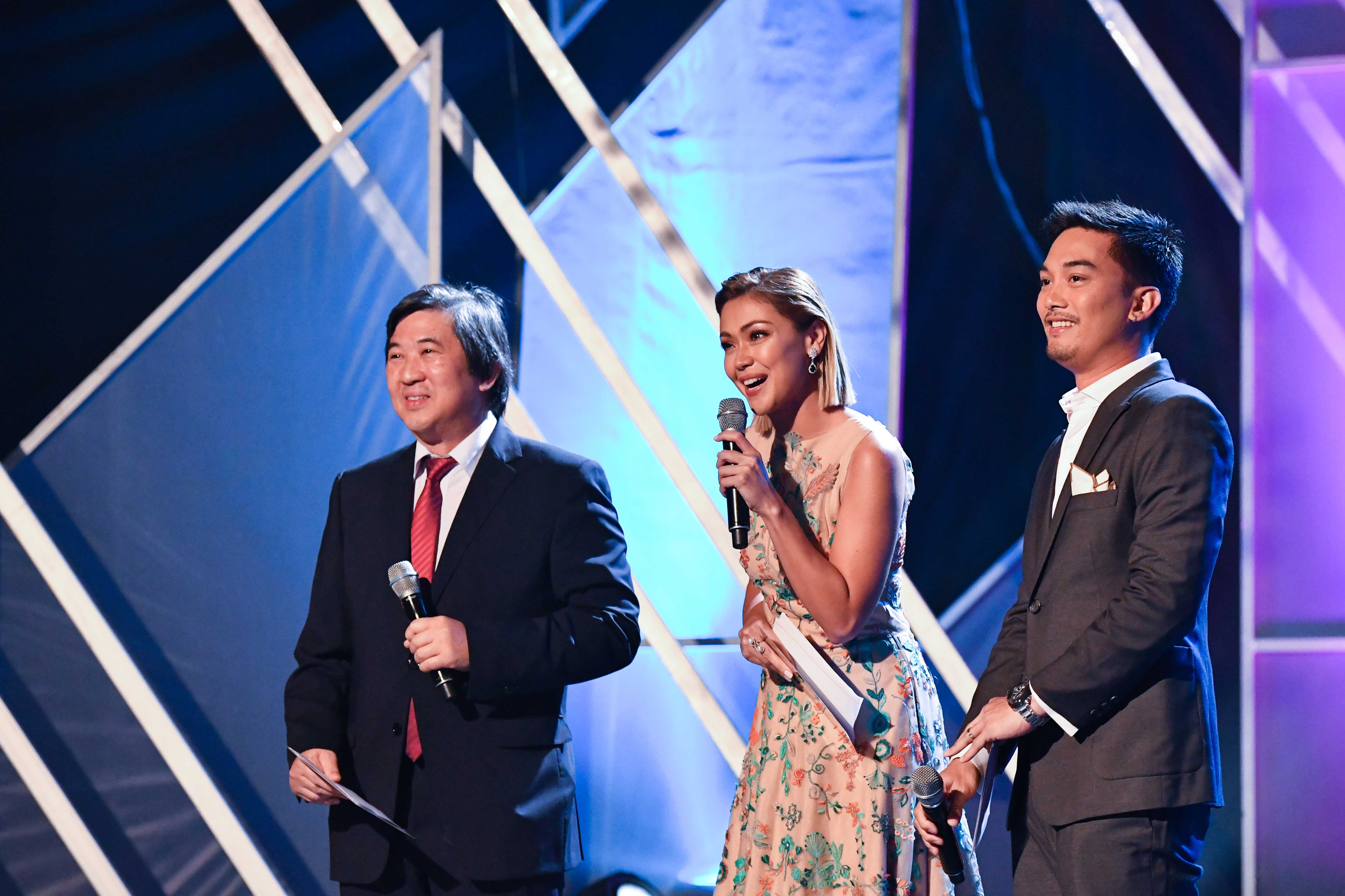 host Cary Lopez shares a light moment with his cohosts, Jodi Santamaria and Miguel Lopez Vargas